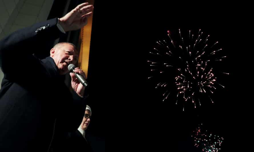 Recep Tayyip Erdoğan addresses supporters from the balcony of AK party headquarters in Ankara on Sunday.
