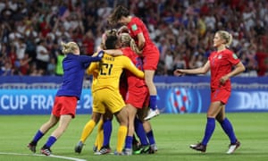 USA players celebrate after winning the match.