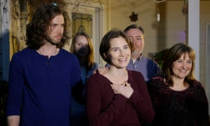 Amanda Knox, centre, stands with her mother, Edda Mellas, right, and her fiance, Colin Sutherland, left
