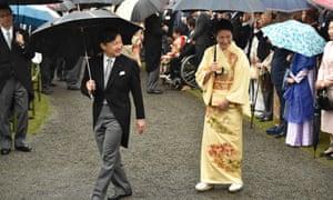 Crown Prince Naruhito and Crown Princess Masako greet guests at garden party in Tokyo.