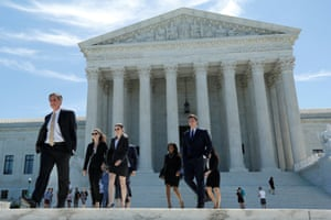 People walk out after the US supreme court granted parts of the Trump administration's emergency request to put his travel ban into effect immediately while the legal battle continues.
