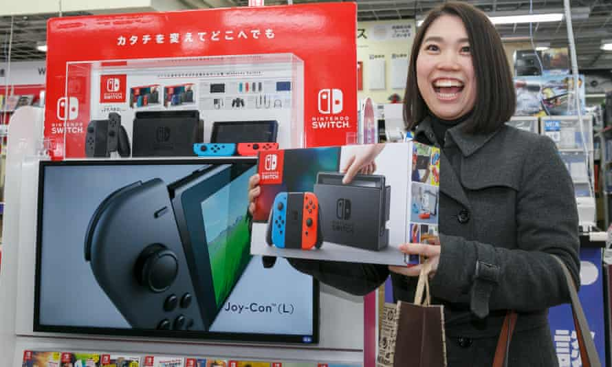 'We're trying to find ways to make people happy' … a player with a Nintendo Switch in Tokyo.