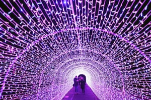 People in the light tunnel at the launch of Edinburgh zoo's Christmas Nights event in Scotland, UK