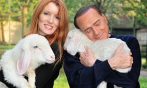 Silvio Berlusconi (right) hugs a lamb as he poses with Michela Vittoria Brambilla, an animal right activist and Forza Italia MP.