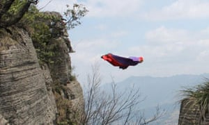 Dean Potter seen diving off the edge of Enshi Canyon in a wingsuit in 2012
