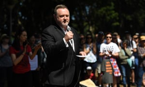 Father Rod Bower announces he will run for the Senate during a rally in Hyde Park, Sydney, on Saturday that called for the closure of the Nauru and Manus Island immigration detention centres.