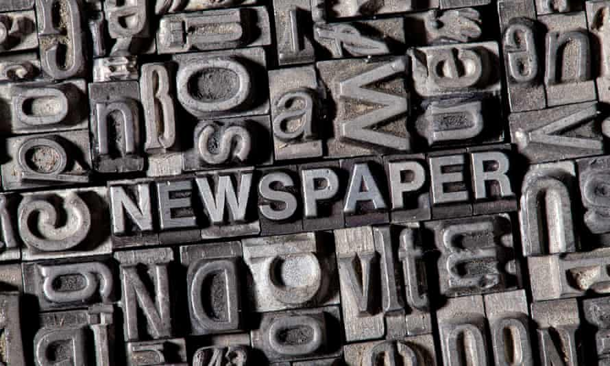 Old lead letters forming the word NEWSPAPER.