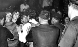 A crowd attempts to impede police arrests outside the Stonewall Inn on Christopher Street in Greenwich Village in June 1969.