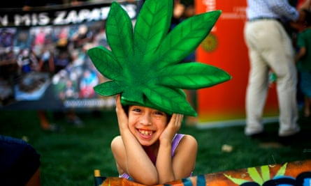 A child wearing a marijuana leaf hat poses during a rally in support of cultivation of cannabis for medicinal purposes in Santiago in March.