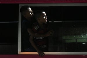 Two boys look out of the window of a bus in San Pedro Sula, Honduras