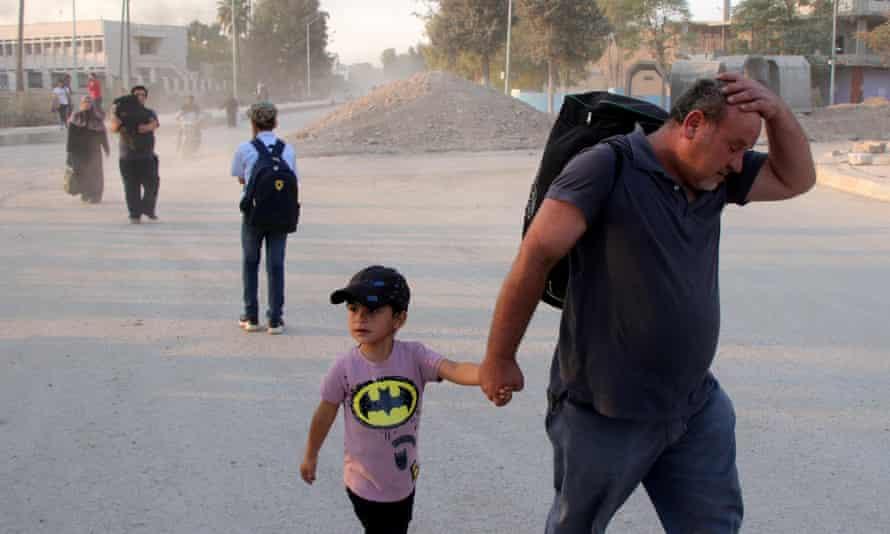 Kurdish families flee their home towns Ras al-Ein due to the Turkish offensive in northern Syria.