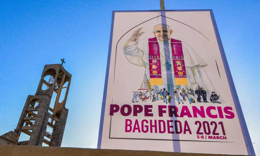 A sign welcoming Pope Francis hangs outside the Syriac Catholic church of Mar Thoma (St Thomas), in the predominantly Christian town of Qaraqosh.