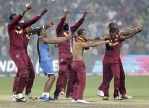 West Indies players perform a victory dance after their win over England.