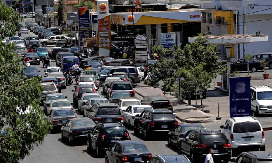 Vehicles queue-up for fuel at a petrol station in Lebanon's capital, Beirut