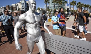 The Silver Surfer carries his surfboard toward the convention center