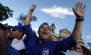 Guatemalan presidential candidate Jimmy Morales appears before a political rally in downtown Guatemala City.