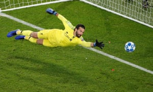 Liverpool's Alisson attempts to save a goal from Paris St Germain's Marquinhos (not pictured), which is disallowed due to offside.