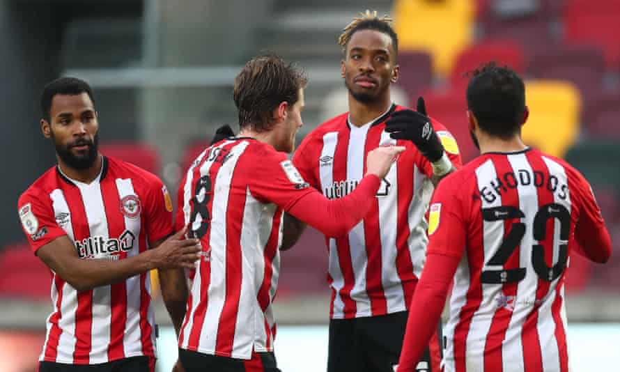 Ivan Toney is congratulated by Rico Henry, Mathias Jensen and Saman Ghoddos after his shot led to a goal credited to Tarique Fosu