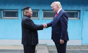 US President Donald Trump shaking hands with North Korean leader Kim Jong-un on the border in the truce village of Panmunjom