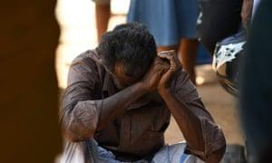 A man weeps outside a hospital in Batticaloa, eastern Sri Lanka.