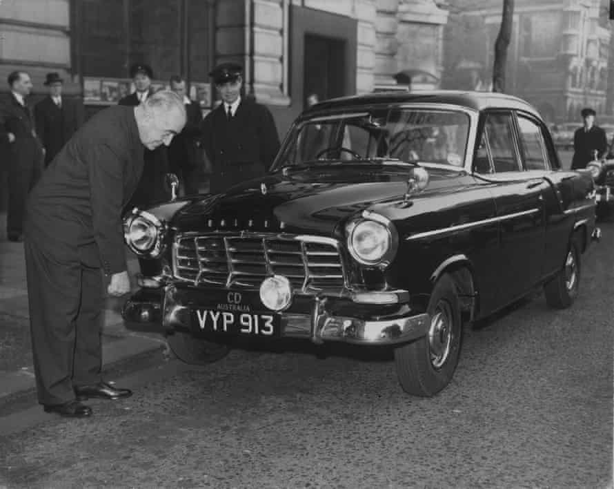 Sir Eric Harrison, the Australian high commissioner in London, inspects the first of five 1958 Holden sedan cars to arrive at Australia House in London, in December 1958