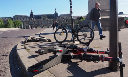 Electric scooters left lying on the Pont du Carrousel in Paris, France.