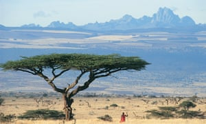 Beautiful country: a Maasai warrior gazes towards Mount Kenya across Laikipia Plain.