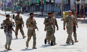 Afghan security forces arrive at the site of a blast in Jalalabad on Monday