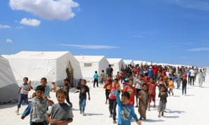 Displaced Syrians take part in a protest against the regime and its ally Russia at a camp near the Bab al-Hawa border crossing with Turkey in Syria's Idlib province on 7 September.
