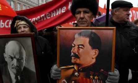 Russian communist party supporters carry portraits of Soviet Union founder Vladimir Lenin and Soviet leader Joseph Stalin on 7 November.