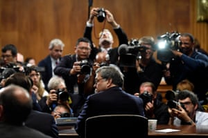 The attorney general, William Barr, is photographed as he sits down to testify before the Senate Judiciary Committee on Capitol Hill in Washington on 1 May 2019.
