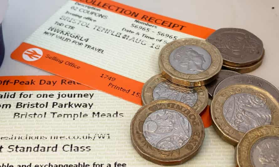 rail ticket and coins