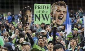 Fans cheer before the MLS Cup championship soccer match between the Seattle Sounders and Toronto FC, Sunday, Nov. 10, 2019, in Seattle. (AP Photo/Elaine Thompson)
