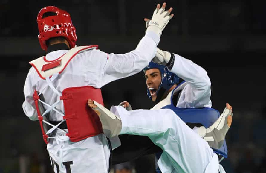 Iran's Sajjad Mardani (left) competes against Pita Taufatofua during the men's taekwondo qualifying bout in the +80kg category at the Rio 2016 Olympics.