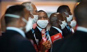 Chauffeurs wearing masks wait for travellers arriving at Cape Town international airport, South Africa.