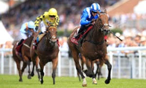 Battaash quickens clear under Jim Crowley to win at Goodwood.