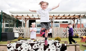 Children play outside at a nursery school in Darlington, County Durham.