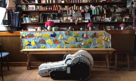 Two guitar cases on the floor in front of the grocery counter at Levis Corner House Ballydehob, West Cork, Ireland.