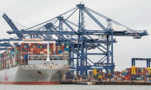 Shipping containers are unloaded from a cargo ship at Felixstowe in Suffolk.