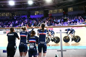 Members of the French team watch the men's team pursuit