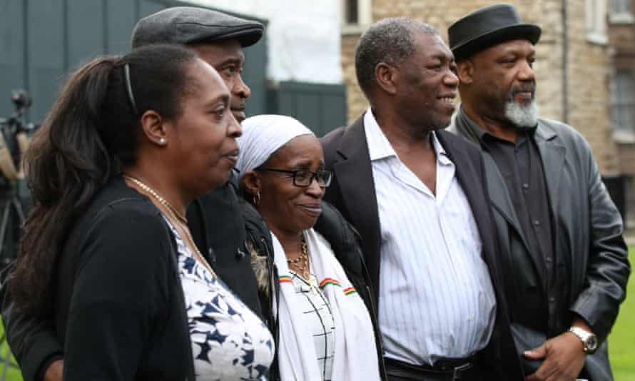 Sarah O'Connor, left, Anthony Bryan, Paulette Wilson, Sylvester Marshall and Elwaldo Romeo outside the Houses of Parliament in May.
