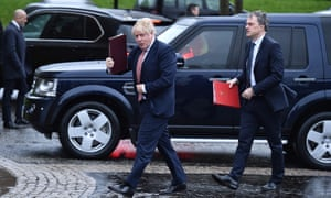 Boris Johnson and Julian Smith, Northern Ireland secretary, arriving at Stormont.