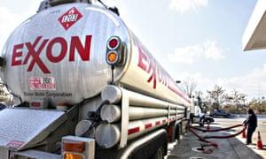 An Exxon tanker truck makes a refuelling stop
