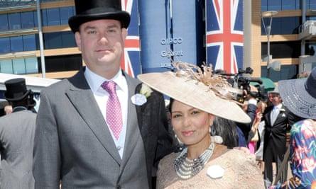 Priti Patel, the home secretary, with her husband, Alex Sawyer, at Royal Ascot.