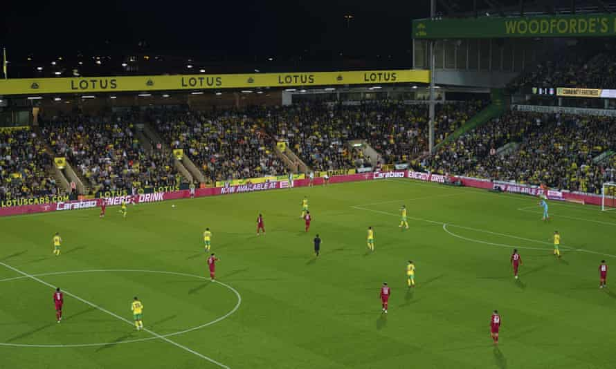 Norwich line up with a three-man defence against Liverpool in midweek