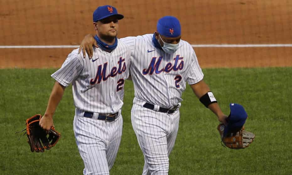JD Davis and Dominic Smith of the New York Mets leave the field after a protest against racism