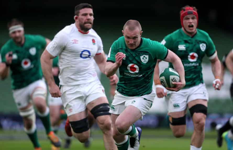 Ireland's Keith Earls runs through to score their first try of the match.