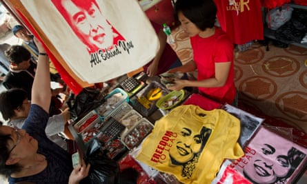 A vendor displays T-shirts bearing the portrait of Aung San Suu Kyi with slogans 'freedom to lead', 'our leader', at the NLD party headquarters in Yangon.