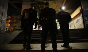 French police officers stand guard in Aulnay-sous-Bois last month after clashes between police and youths.