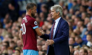 Andriy Yarmolenko is congratulated by West Ham's manager Manuel Pellegrini on being substituted after playing a key role in his side's first league win of the season.